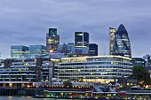 London skyline seen from the River Thames at twilight poster