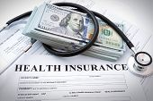 Health insurance form with banknote and stethoscope poster