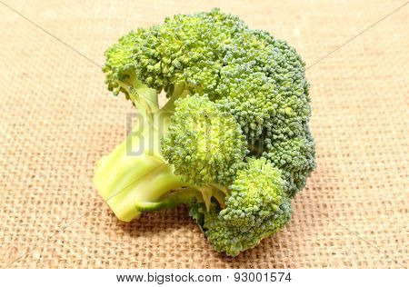 Portion of fresh raw green broccoli on jute canvas branches of broccoli concept for healthy eating poster