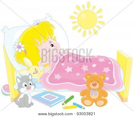 Little girl waking up in her small bed poster
