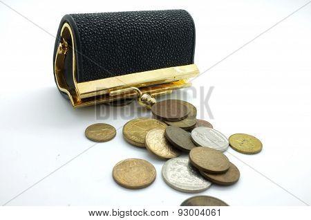 International coins and black wallet, pocket