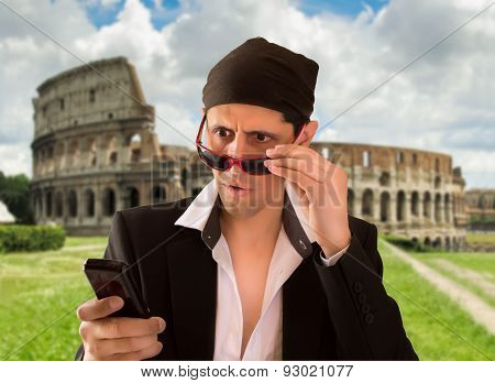 latin lover doing a little illegal web browsing with cellphone in rome poster