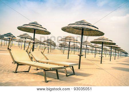 Straw Umbrellas And Sunbeds At Rimini Beach In Italy - Top Destination In Emilia Romagna