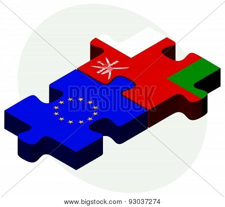 European Union and Oman Flags in puzzle isolated on white background. poster