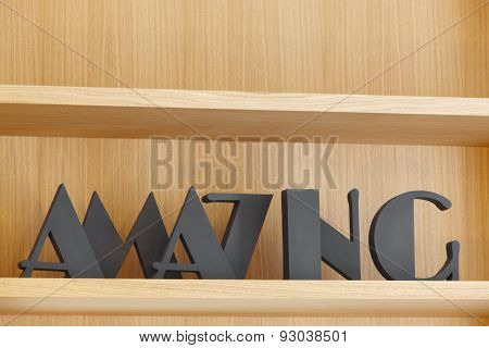 Amazing Text In Black Color Over A Wooden Bookshelf