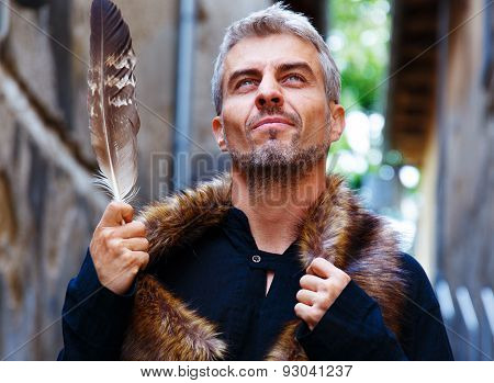 Portrait Of A Sexy Man And Wolf Furry And Eagle Feathers, A Disgruntled Expression On His Face.