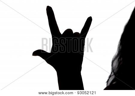 Silhouette of woman showing three-toed horns