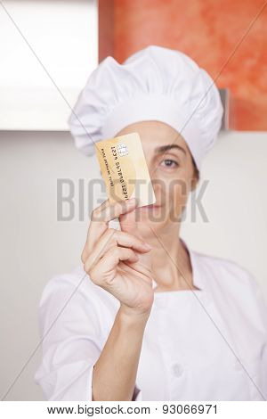Credit Card In Woman Chef Hand
