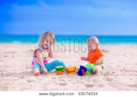 Kids Building A Sand Castle On A Beach