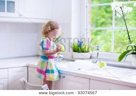 Little Girl Washing Dishes