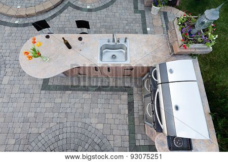 Outdoor Summer Kitchen With Barbecue And Sink