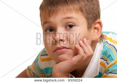 Portrait Of A Sad Boy With Big Grey Eyes