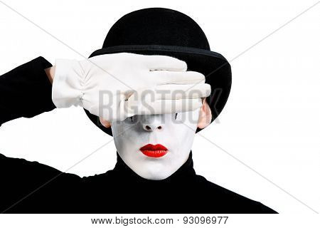 Close-up portrait of a male mime artist closing his eyes with his hand. Isolated over white.