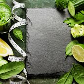Fresh green vegetables and smoothie on vintage background - detox, diet or healthy food concept poster