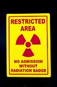 A safety sign that restricts admission to the radiation area poster