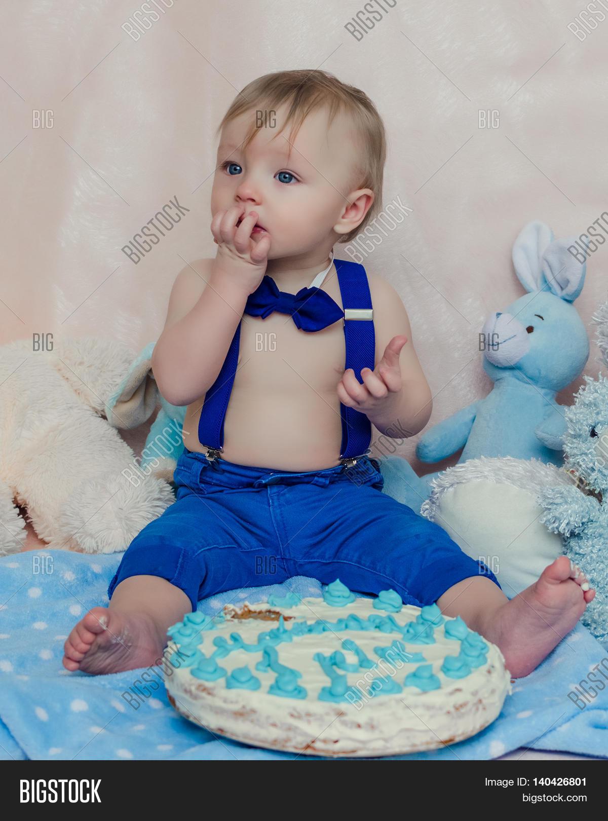 Funny Baby Boy Tasting Cake Blue Image &