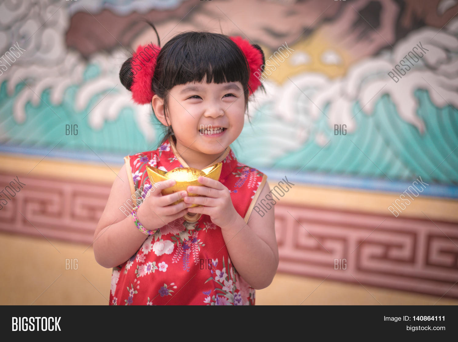 China girl traditional image photo free trial bigstock china girl in traditional chinese dress greeting holding a gold ingot standing m4hsunfo