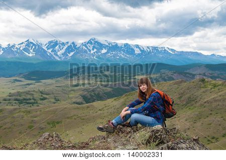 traveler with backpack on a background of mountain