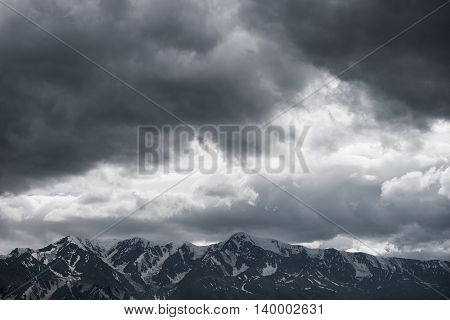 beautiful dark landscape of mountains with clouds