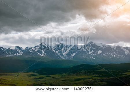 landscape of mountains and steppe on sunset background