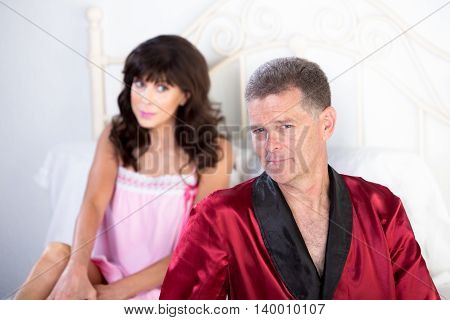 Pretty Woman Gazes At Retro Playboy