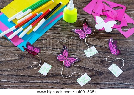 The Child Makes Decoration Paper Paper Butterfly In A Glass. Child Glues Paper Portion Of The Articl