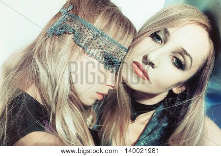 Portrait of two beautiful young women close-up