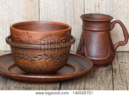 Set Home Brown Ceramics For The Kitchen. The Ware From Clay. Utensils