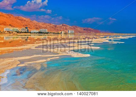 Lowering the water level in the Dead Sea. Evaporated salt out of the water with beautiful patterns