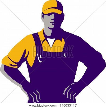 Illustration of an organic farmer wearing hat and overalls with hands on hips akimbo facing front set on isolated white background done in retro style.