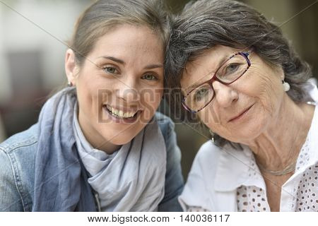 Portrait of elderly woman with home carer