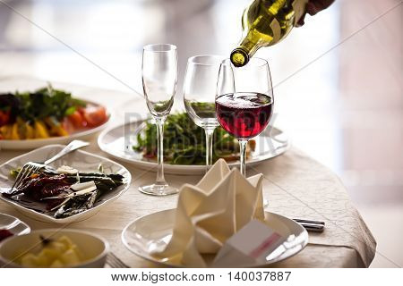 Glasses set with drinks in restaurant. Fine dining