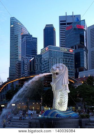 Statue in Singapore.  Singapore, Asia - June 05, 2016 Merlion- statue of a combination of Leo and Pisces, the national symbol of Singapore squirting water at Merlion Park.