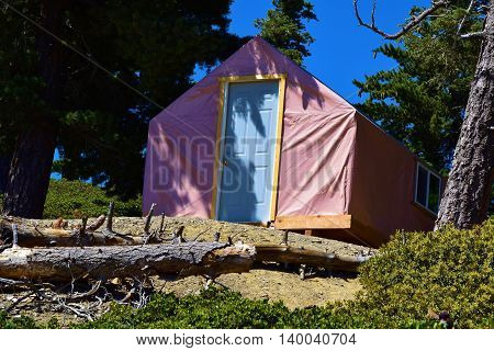 Modern and rustic tent cabin taken at a pine forest in Mt Baldy, CA