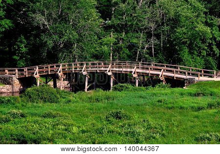 Concord Massachusetts - July 12 2015: Historic Old North Bridge over the Sudbury River site of the first Battle of the Revolutionary War between the Colonists and the British