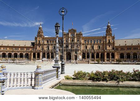 SEVILLE, SPAIN - September 13, 2015: The Plaza de Espana (Spain Square) is a plaza built for the Expo 1929 in Renaissance Revival and Moorish Revival styles on September 13, 2015 in Seville, Spain