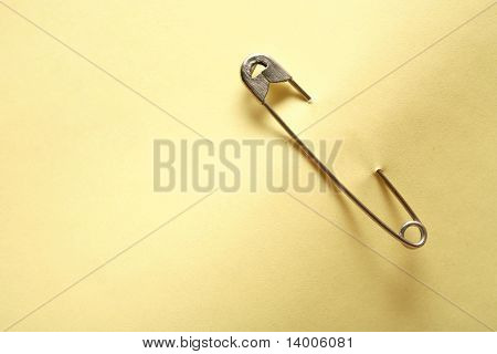 Blank yellow adhesive note attached with safety pin poster