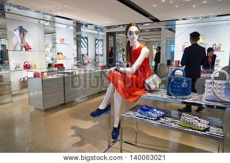 HONG KONG - MAY 12, 2016: Dior store in Hong Kong International Airport. Hong Kong International Airport is the main airport in Hong Kong. It is located on the island of Chek Lap Kok.