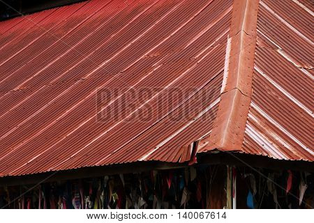 Wooden house tin roof old rusty zinc roof