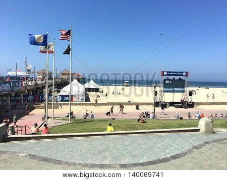 HUNTINGTON BEACH-CALIFORNIA - JULY, 26, 2016: US Open of Surfing at the pier in Huntington Beach, CA. Video displays are set up for fans along the beach front.