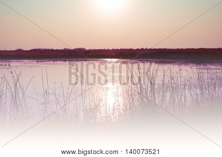 Scenic sunset over the lake, soft abstract natural background, pastel vintage effect
