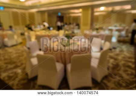 Blurred Image Of Large Dining Table Set For Wedding, Dinner Or Festival Event