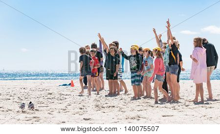 Mount Maunganui - November 4, 2012; Nippers coaching event on Mount Maunganui Beach respond to their coach raising arms signalling they know answer.