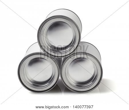 Stack of Tin Cans Lying on White Background