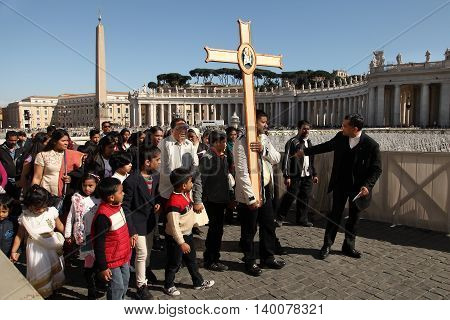 Rome Italy - APRIL 10 2016: Groupe of pilgrims going to St Peter basilica Vatican City St Peter square Rome Italy