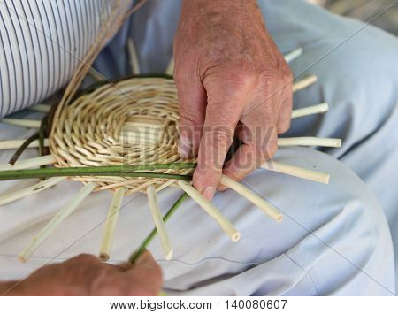 Craftsman While Creating A Wicker Basket