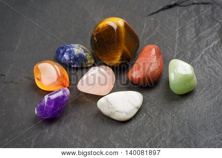 heap of gemstone against black background, sacred gemstone
