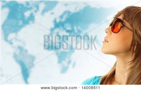 Young woman in red glasses near world map