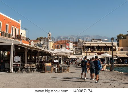 CHANIA, GREECE - JULY 9, 2016:Tavernas and restaurants surrounding the harbour of Chania Crete Greece