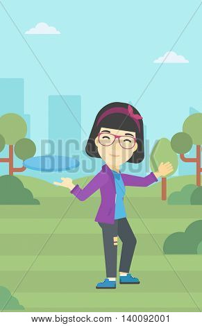 An asian sportive woman playing flying disc in the park. Young woman throwing a flying disc. Sportswoman catching flying disc outdoors. Vector flat design illustration. Vertical layout.